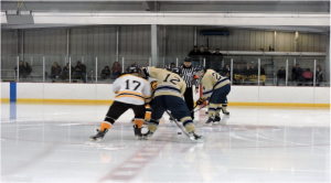 Sophomore forward Dan Merz takes the opening faceoff against Wooster – Photo by PJ Dumnich
