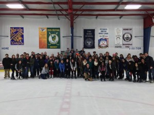 Fans and players gather around for a group photo during the free skate – Photo by PJ Dumnich