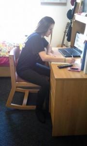 Pitt-Greensburg student Kaitlyn Schmidt a VAPA major often studies with her shoes on. (Photo by Jessica Stewart).