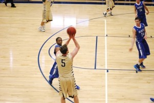 Brian Heinle shoots a three pointer on the night he earns his 1,000 career point