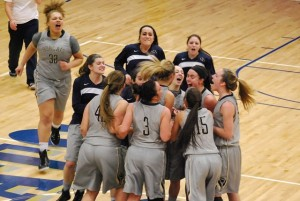 The Women's Basketball team celebrates their February 24 victory against Franciscan – Courtesy of www.pittgreensburgathletics.com