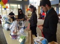 Tara Ritenour, junior psychology major, and Tyler Lookabaugh, junior psychology major, put tickets into the prize baskets