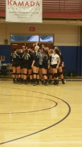 Women's Volleyball Team cheers before their game. Photo by Rebecca Robinson